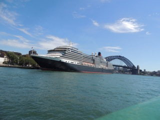 Queen Victoria docked between the bridge and the Opera House